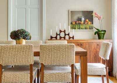 A Modern classic colonial, dining room, wood table, dresser, ligting, orchid